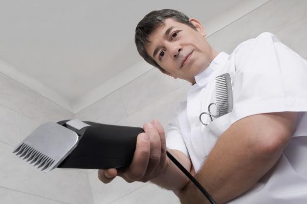 vet holding an electric razor