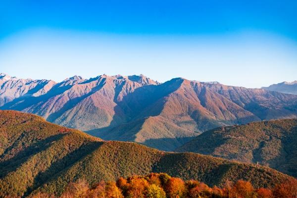 caucasus mountains landscape with a blue