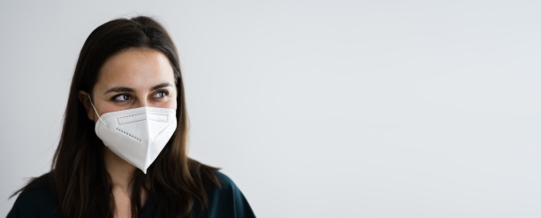 receptionist woman in medical face mask