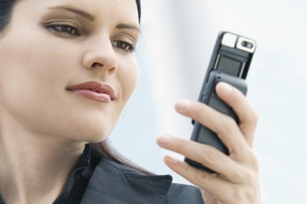 closeup of a businesswoman text messaging