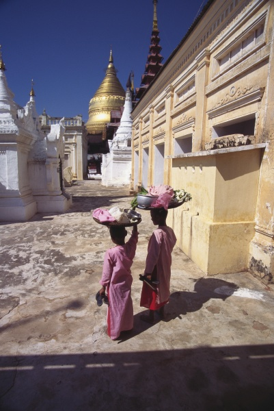 rear view of two nuns carrying
