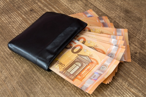 money in black leather wallet