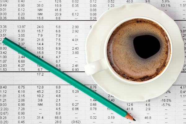 coffee cup on financial highlight page