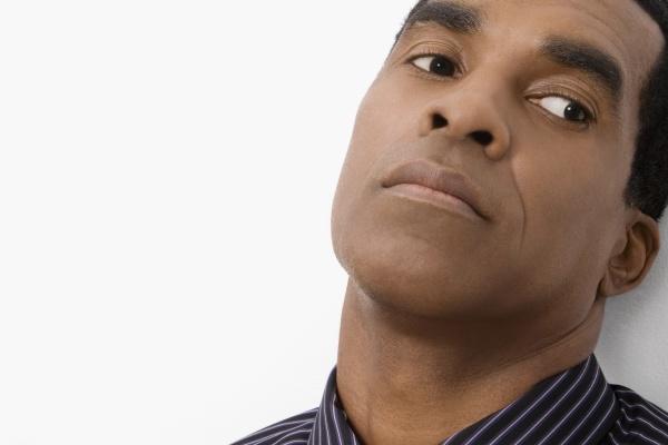 closeup of a mature man thinking
