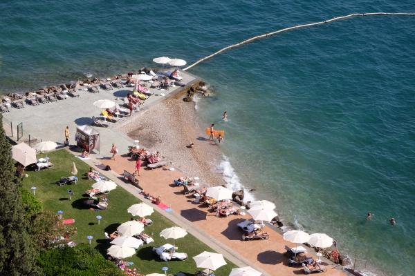 tourists enjoy the beach in portoroz