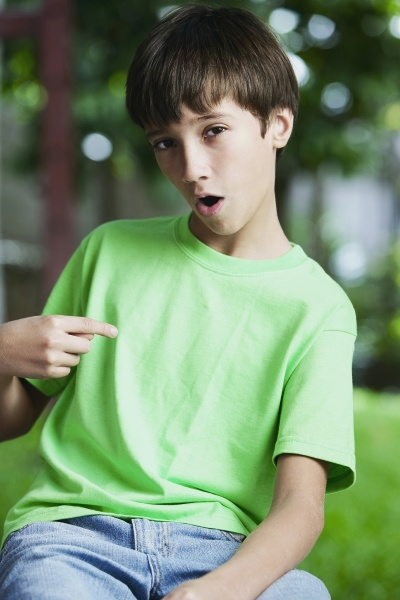 portrait of a boy pointing to