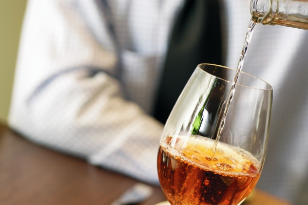 close up of wine being poured