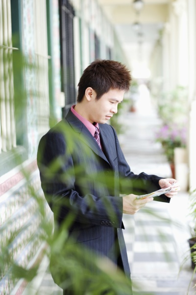 side profile of a businessman reading