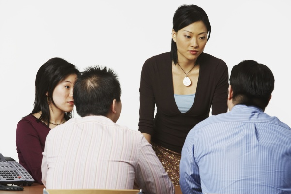 businesswoman talking to her colleagues in