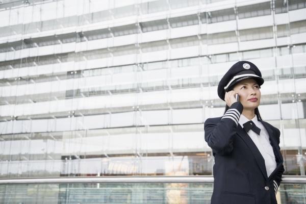 female pilot talking on a mobile