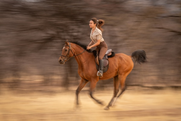 slow pan of brunette riding past