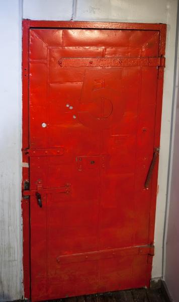 vintage door painted red with number