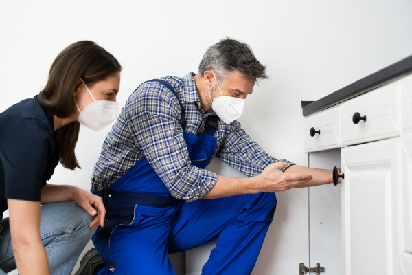 kitchen pipe damage problem woman and