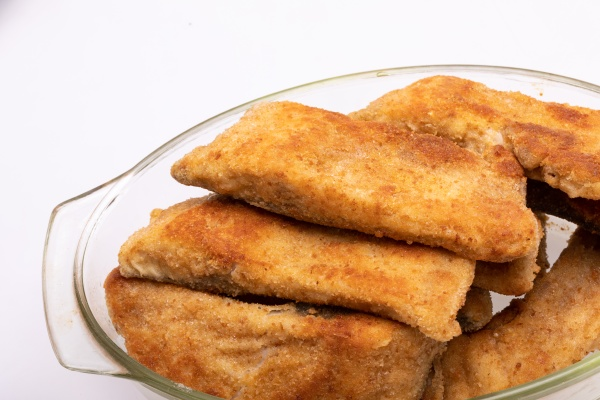 breaded fish fillets in a glass