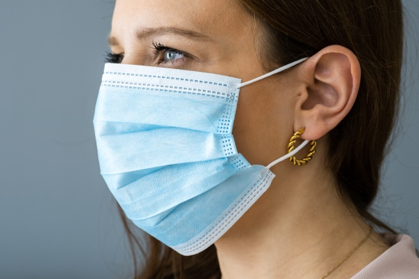 receptionist woman wearing covid face mask