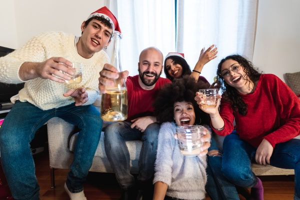 friends raising a toast with drinks