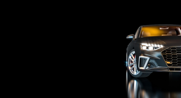 black luxury car with lighted headlights