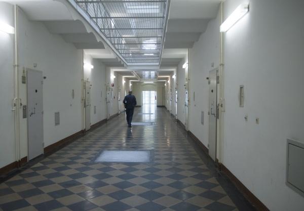 prison guard walking down corridor of