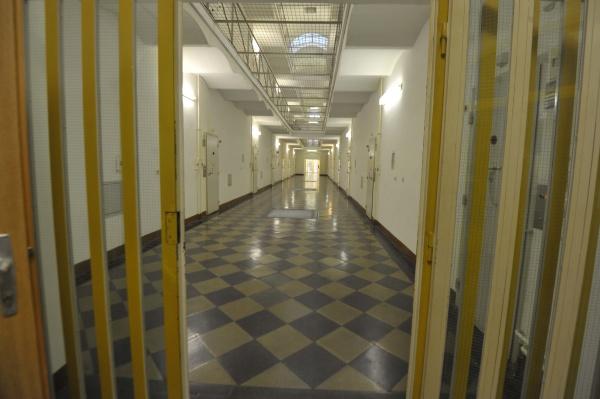 the empty corridor of a prison