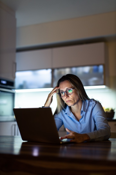 pretty middle aged woman working late