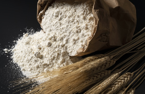 flour and ears of wheat on