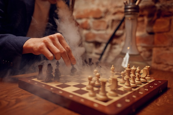 young man at the chessboard in