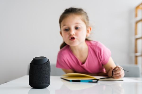 child kid using smart speaker