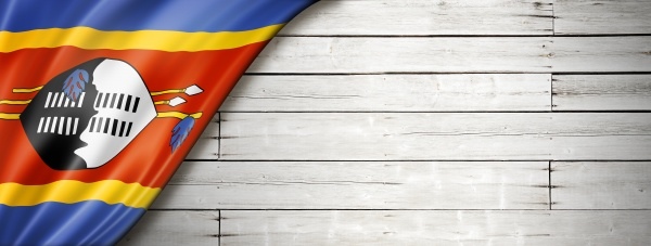 swaziland flag on old white wall
