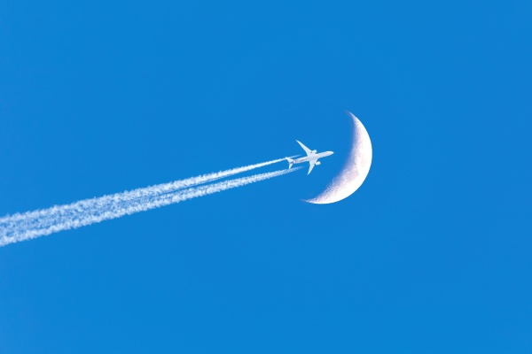 passenger plane passes near the moon