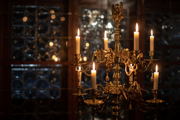 splendid chandelier with lit candles in