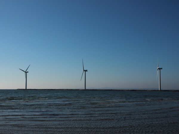 line of offshore windmill turbine at