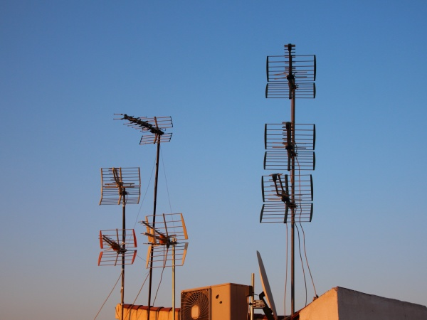 antennas on roof with blue sky