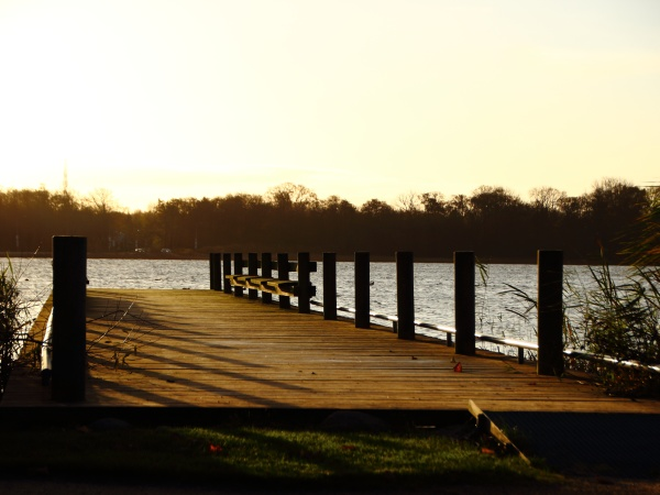 old wooden pier at lake in