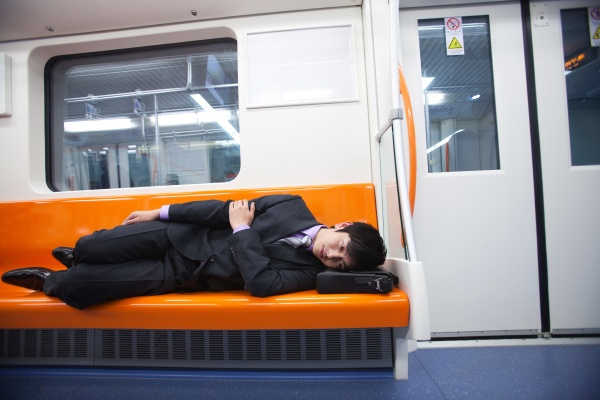 a man riding the subway while
