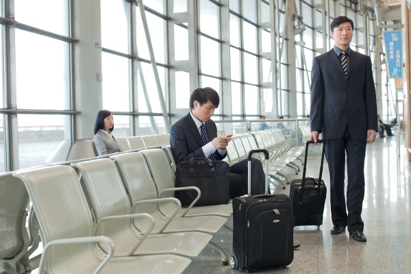 waiting railway station airport asians a