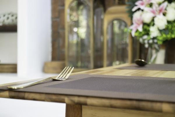 golden metal fork on dining table