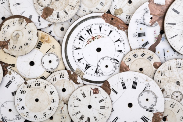 group of damaged antique watch faces