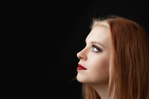 head of beautiful redhead young woman