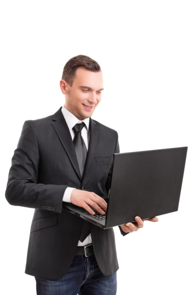 attractive businessman holding a laptop and
