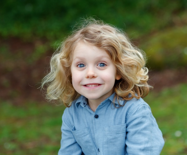 happy child with long blond hair