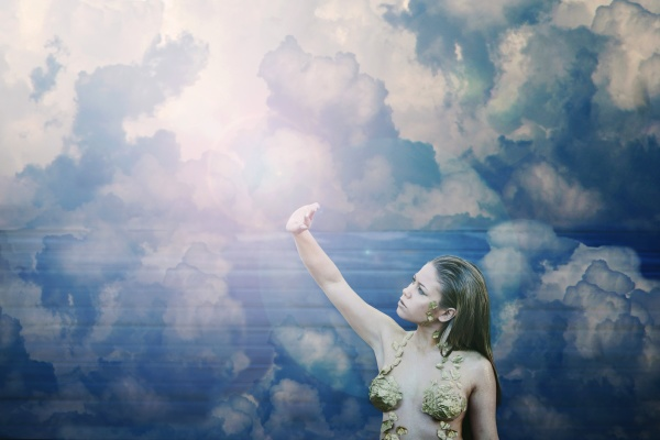 beautiful girl among the clouds
