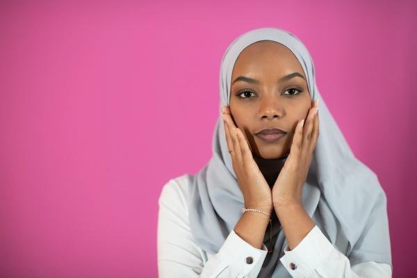 african muslim woman makes traditional prayer