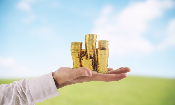 businessman hold piles of money concept