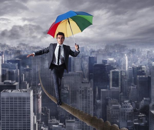 equilibrist businessman walk on a rope