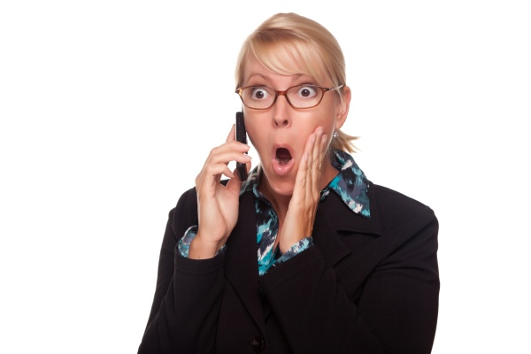 blonde woman shocked on cell phone