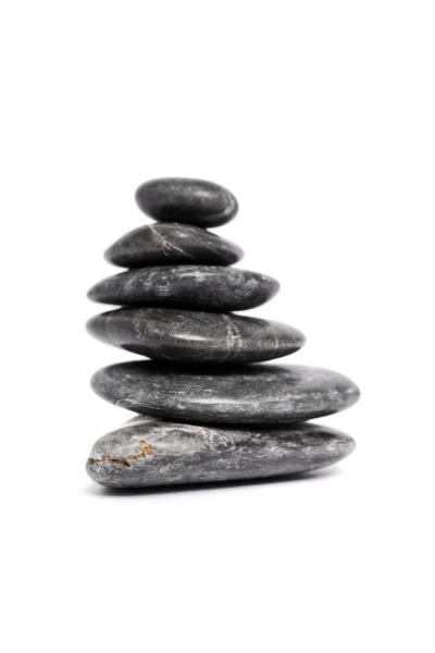 zen stones stacked on top of