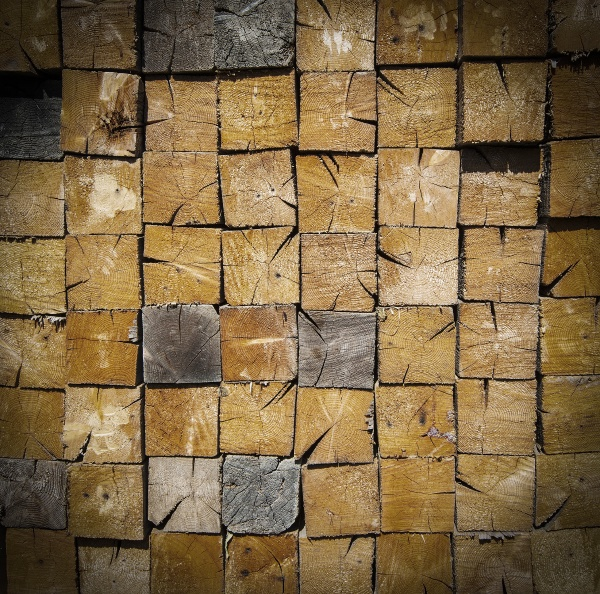 background of stacked wood cut close