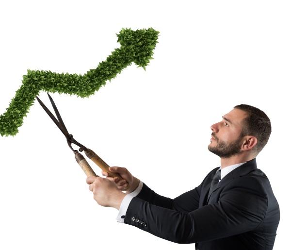 businessman that cuts and adjusts a