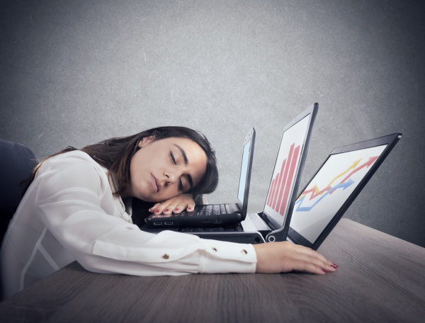 female worker falls asleep while simultaneously