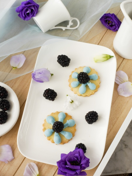 cheese decorated with blue buttercream and